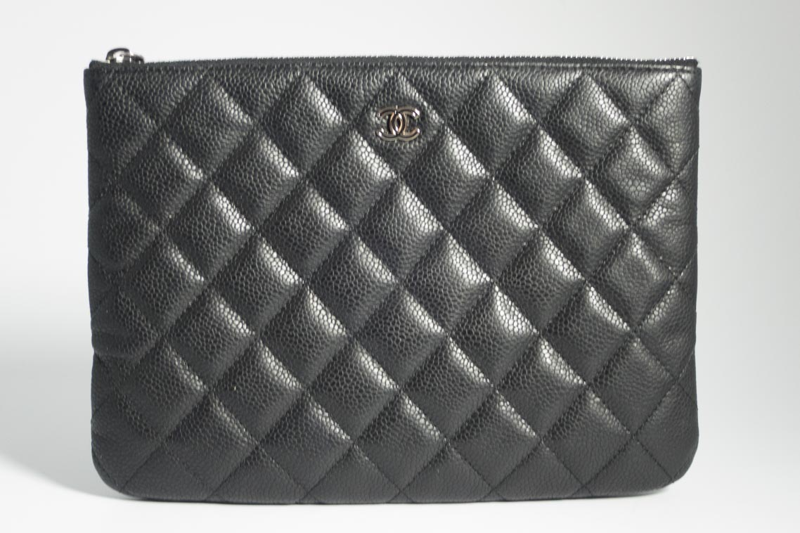 744ae802dd039c Previous; Next. 1; 2; 3. Previous; Next. Authentic Preloved Chanel O case  Pouch Clutch Bag in Black Caviar Leather ...