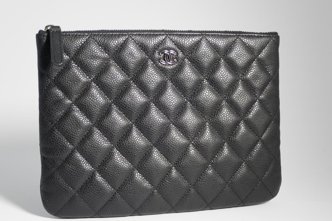 d1fd3a21240ed4 Previous; Next. 1; 2; 3. Previous; Next. Authentic Preloved Chanel O case  Pouch Clutch Bag in Black Caviar Leather with Silver Hardware